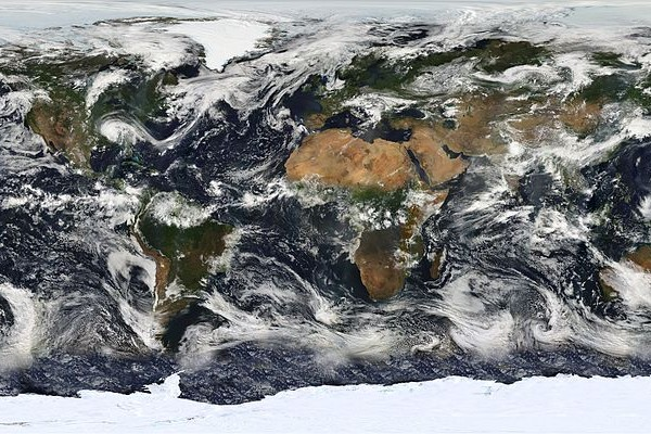 This image is based largely on observations from the Moderate Resolution Imaging Spectroradiometer (MODIS) - a sensor aboard the Terra satellite - on July 11, 2005. Small gaps in MODIS' coverage between overpasses, as well as Antarctica (which is in polar darkness in July), have been filled in using GOES weather satellites and the latest version of the NASA Blue Marble. Hurricane Dennis can be seen moving inland over the Gulf Coast.